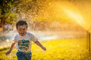 Child in Sprinkler