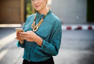woman dressed professionally on phone